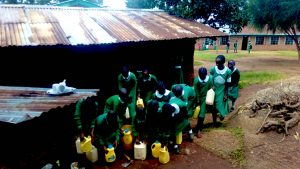 The Water Project:  Girls Getting Their Water Containers