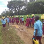 The Water Project: Namalasire Primary School -  Carrying Water Back To School