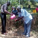 The Water Project: Maganyi Community, Bebei Spring -  Handwashing Training