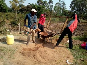 The Water Project:  Men Helping Sift Sand For Construction