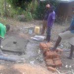 The Water Project: Musango Community, Dawi Spring -  Sanitation Platform Construction