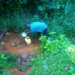 The Water Project: Shirakala Community -  Kenya Drawing Water From The Unprotected Water Point