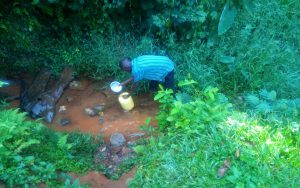 The Water Project:  Kenya Drawing Water From The Unprotected Water Point