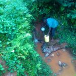 The Water Project: Shirakala Community -  Kenya Filling Jerrycan With Spring Water