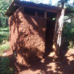 The Water Project: Shirakala Community -  Kenya Latrine With Mud Walls And Metal Roof