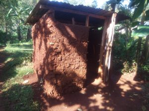 The Water Project:  Kenya Latrine With Mud Walls And Metal Roof