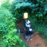 The Water Project: Shirakala Community -  Kenya Woman Carries Jerrycan Of Water On Her Head
