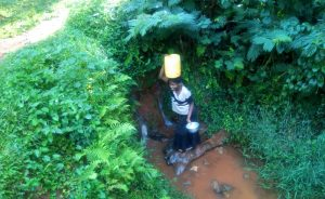 The Water Project:  Kenya Woman Carries Jerrycan Of Water On Her Head