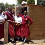 The Water Project: George Khaniri Kaptisi Mixed Secondary School -  Girls Stand With New Latrines