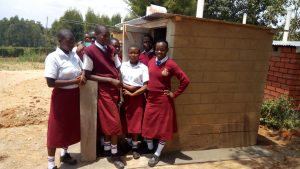 The Water Project:  Girls Stand With New Latrines