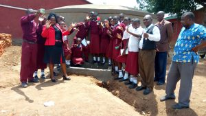 The Water Project:  Students And Staff Post With New Tank
