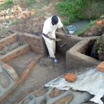 The Water Project: Musango Community D -  Cementing Protected Spring