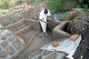The Water Project:  Cementing Protected Spring