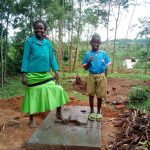 The Water Project: Musango Community D -  Standing With New Latrine Platform