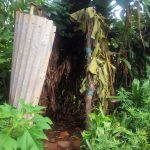 The Water Project: Emulakha Community -  A Bathroom In The Middle Of Banana Plantation Covered With Twigs And Banana Leaves