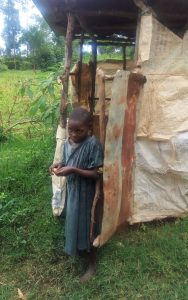 The Water Project:  Child Stands Outside Of Latrine