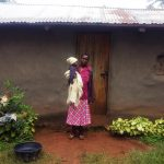 The Water Project: Emulakha Community -  Woman And Child Infront Of Home