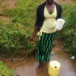 The Water Project: Emulakha Community, Alukoye Spring -  Woman Stands In Spring