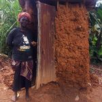The Water Project: Emulakha Community -  Woman Stands Next To Latrine