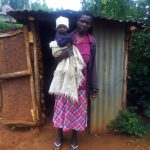 The Water Project: Emulakha Community -  Woman Stands With Her Child