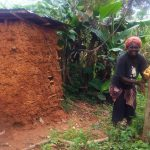 The Water Project: Emulakha Community -  Woman Uses Improvized Handwashing Station