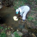 The Water Project: Handidi Community C -  Collecting Water From The Spring