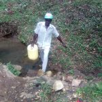 The Water Project: Handidi Community C -  Man Carries Jerrycan Filled With Water Away From Spring