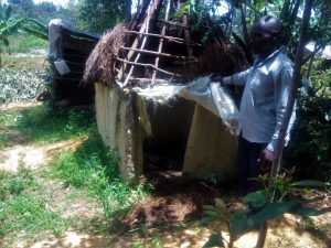 The Water Project:  Mr Edgera Water User Stands Beside His Latrine