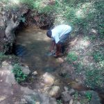 The Water Project: Handidi Community C -  Washing Hands In The Spring