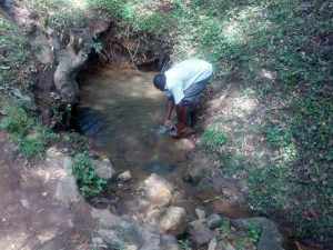 The Water Project:  Washing Hands In The Spring