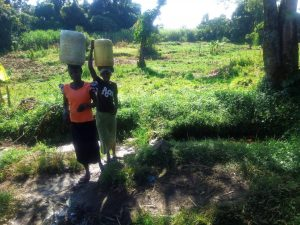 The Water Project:  Community Members Carrying Water From The Spring