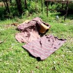 The Water Project: Irumbi Community -  Bedding Left To Dry On The Ground