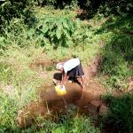 The Water Project: Irumbi Community -  Drawing Water At Okanga Spring