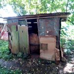 The Water Project: Irumbi Community, Okang'a Spring -  Latrine Made Of Old Iron Sheets