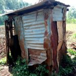 The Water Project: Irumbi Community, Okang'a Spring -  Latrine With Metal Sides And Metal Roof