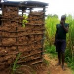 The Water Project: Burachu B Community A -  A Boy Poses Next To His Familys Latrine