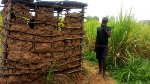 The Water Project:  A Boy Poses Next To His Familys Latrine