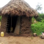 The Water Project: Burachu B Community A -  A Sample Latrine With A Water Container For Handwashing