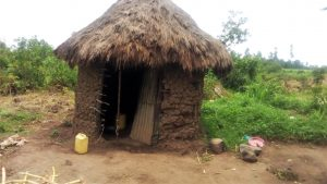 The Water Project:  A Sample Latrine With A Water Container For Handwashing