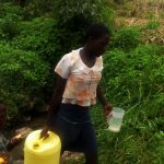 The Water Project: Burachu B Community A -  Carrying Filled Jerrycan From Spring
