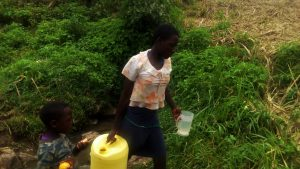 The Water Project:  Carrying Filled Jerrycan From Spring