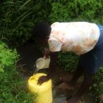 The Water Project: Burachu B Community A -  Lilian Ogot Fetching Water At The Spring