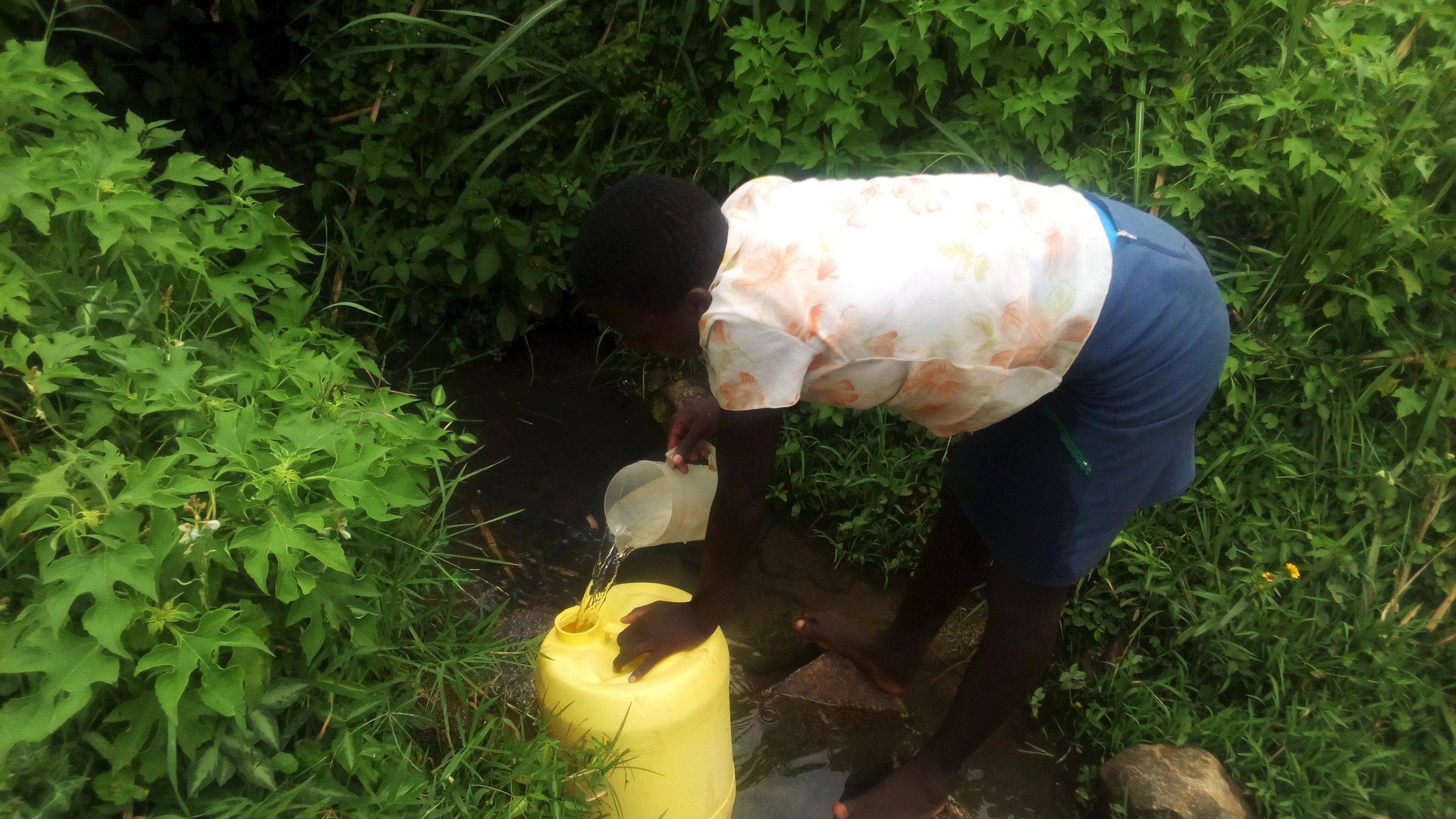 The Water Project : kenya18132-lilian-ogot-fetching-water-at-the-spring