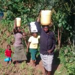 The Water Project: Musiachi Community -  Carrying Water From The Spring