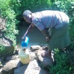 The Water Project: Musiachi Community -  Fetching Water At Thomas Spring