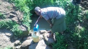 The Water Project:  Fetching Water At Thomas Spring
