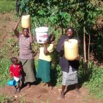 The Water Project: Musiachi Community -  Lifting Jerrycans Filled With Water Onto Heads