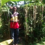 The Water Project: Musiachi Community -  Man Stands With Improvized Latrine