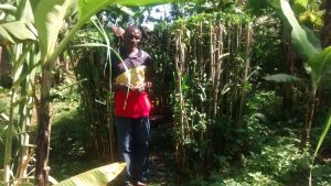 The Water Project:  Man Stands With Improvized Latrine