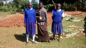 The Water Project:  Mrs Indole With Her Girls At Their Compound